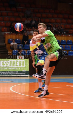 KAPOSVAR, HUNGARY - SEPTEMBER 30: Bence Bozoki (with ball) in action at a Hungarian National Championship volleyball game Kaposvar (green) vs. PEAC (white), September 30, 2016 in Kaposvar, Hungary.