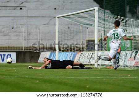 KAPOSVAR, HUNGARY - SEPTEMBER 14: Szabolcs Balajcza (goalkeeper in action at a Hungarian Championship soccer game - Kaposvar (white) vs Ujpest (purple) on September 14, 2012 in Kaposvar, Hungary. - stock photo