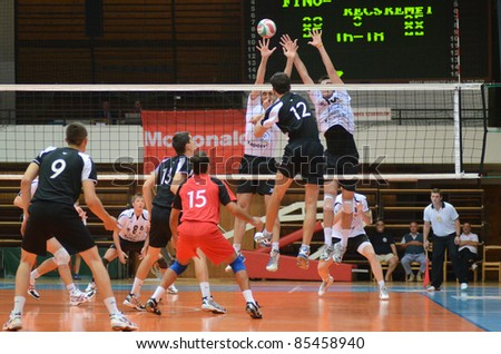 KAPOSVAR, HUNGARY - SEPTEMBER 21: Unidentified players in action at a Hungarian National Championship volleyball game Kaposvar (white) vs. Kecskemet (black), September 21, 2011 in Kaposvar, Hungary.