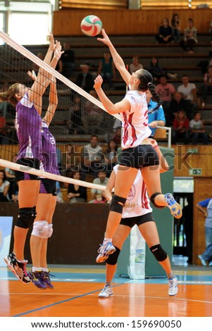 KAPOSVAR, HUNGARY - SEPTEMBER 20: Zs�³fia Harmath (white 3) in action at the Hungarian I. League volleyball game Kaposvar (white) vs Ujpest (purple), September 20, 2013 in Kaposvar, Hungary. - stock photo
