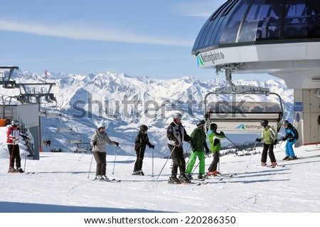 KAPRUN, AUSTRIA - CIRCA MARCH 2012: Unidentified skiers enjoy the last ski week of the season at a mountain lodge in the Zell am See ski resort circa March, 2012 in Zell am See, Austrian Alps - stock photo