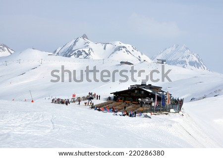 KAPRUN, AUSTRIA - CIRCA MARCH 2012: Unidentified skiers enjoy the last ski week of the season at a mountain lodge in the Zell am See ski resort circa March, 2012 in Zell am See, Austrian Alps