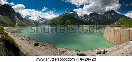 Kaprun Dam, lake and Alps in Austria - stock photo