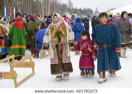 "Kar-Nat, Russia - February 23, 2016: Nenets national holiday ""Day of the reindeer herders"" in the Yamal Peninsula, Nenets in national clothes, Kar-Nat, 22 February 2016"