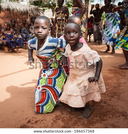 KARA, TOGO - MAR 11, 2012:  Unidentified Togolese children in traditional dress dance the religious voodoo dance. Voodoo is the West African religion - stock photo