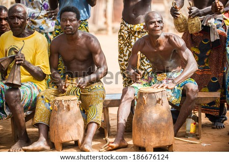 KARA, TOGO - MAR 11, 2012:  Unidentified Togolese drummers make music for the religious voodoo dance performance. Voodoo is the West African religion - stock photo