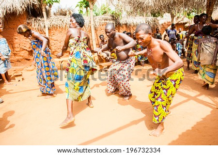 KARA, TOGO - MAR 11, 2012:  Unidentified Togolese people in a traditional clothes dance the religious voodoo dance. Voodoo is the West African religion - stock photo