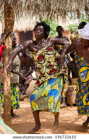 KARA, TOGO - MAR 11, 2012:  Unidentified Togolese woman in a traditional dress dances the religious voodoo dance. Voodoo is the West African religion