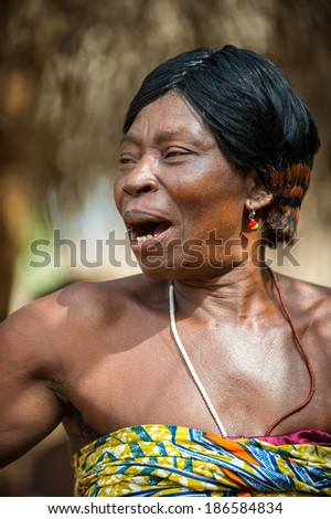 KARA, TOGO - MAR 11, 2012:  Unidentified Togolese woman in traditional dress dances the religious voodoo dance. Voodoo is the West African religion