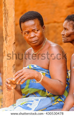 KARA, TOGO - MAR 11, 2012:  Unidentified Togolese woman watches the religious voodoo dance. Voodoo is the West African religion