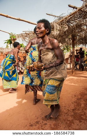 KARA, TOGO - MAR 11, 2012:  Unidentified Togolese women in traditional dress dance the religious voodoo dance. Voodoo is the West African religion