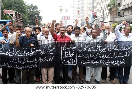 KARACHI, PAKISTAN - AUG 16: Journalists are protesting in favor of their demands during a demonstration arranged by Karachi Union of Journalists (KUJ) at press club on August 16, 2011, Pakistan - stock photo