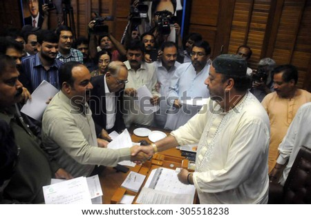 KARACHI, PAKISTAN - AUG 12: MQM  showing their resignation letters to media persons as they are at Speaker Secretariat to submit resignations to Agha Siraj Durrani, on August 12, 2015 in Karachi.