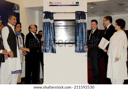 KARACHI, PAKISTAN - AUG 18: Sindh Chief Minister, inaugurating Maternity Ward, which is being constructed with the assistance of USAID during inaugurating ceremony on August 18, 2014 in Karachi.  - stock photo
