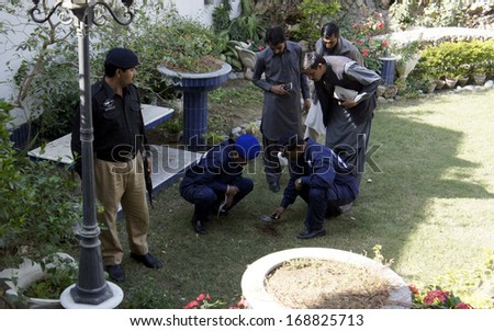 KARACHI, PAKISTAN - DEC 27: Rescue volunteers are gathering at house where a hand grenade blast occurred caused a seven year old girl Uzma dead and a boy injured, on December 27, 2013 in Karachi.
