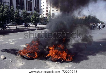 KARACHI, PAKISTAN - FEB 28: View of burning tyres which were set ablaze by angry protesters burn tyres at road during protest demonstration on February 28, 2011 in Karachi.