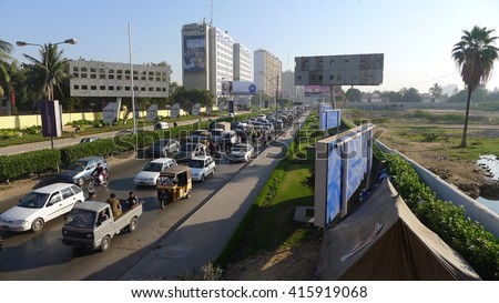 KARACHI, PAKISTAN - FEBRUARY 07: Negligence of traffic police department, large numbers of vehicles are in traffic jam on February 07, 2016 in Karachi.