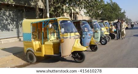 KARACHI, PAKISTAN - FEBRUARY 07: Tuk-tuk Scooter Taxi in Pakistan on February 07, 2016 in Karachi.  - stock photo