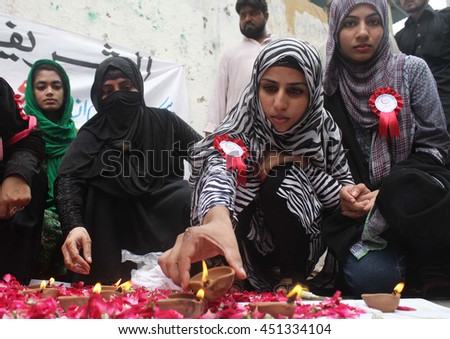 KARACHI, PAKISTAN - JUL 12: Members of Al-Shareef Foundation are enlightening earthen lamps as they are presenting tribute to renowned social worker Abdul Sattar Edhi (late), on July 12, 2016.