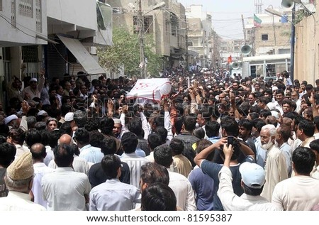 KARACHI, PAKISTAN - JUL 24: People carry coffin of Mukhtar Bukhari advocate who was gunned down by unidentified gunmen yesterday, for burial after offer his funeral prayer on July 24, 2011in Karachi, Pakistan.