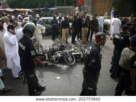 KARACHI, PAKISTAN - JUL 04: Views after blast which left at least two people have lost their lives and three people were injured on Preedy Street of the Saddar area on July 04, 2014  in Karachi.
