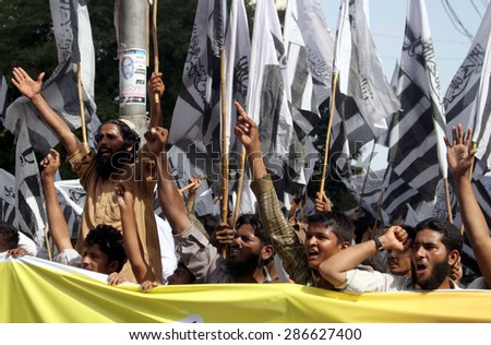 KARACHI, PAKISTAN, JUN 12: Activists of Jamat-ud-Dawah are protesting against India and massacre of Muslims by Buddhist in Burma during a rally on June 12, 2015 in Karachi.