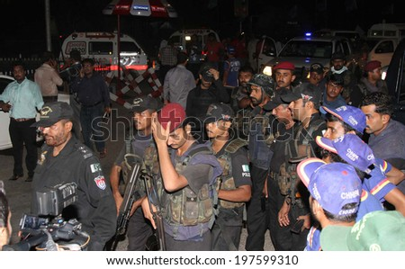 KARACHI, PAKISTAN - JUN 09: Pakistani security forces secure the Jinnah International  Airport after suspected militants attacked the airport, on June 09, 2014 in Karachi.  - stock photo