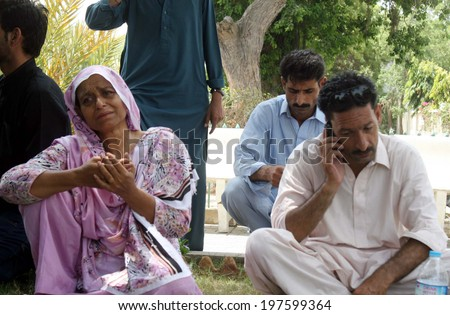 KARACHI, PAKISTAN - JUN 09: Relatives of missing Airport Security Force personnel wait for the updates after suspected militants attacked the Karachi Airport on June 09, 2014  in Karachi.  - stock photo