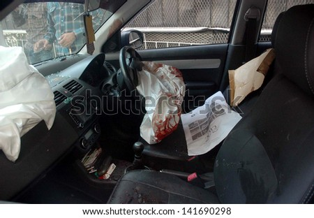 KARACHI, PAKISTAN - JUN 10: View of riddles car on which Engineer Mohsin Raza Abidi was on drive and assassinated by unidentified gunmen at Nazimabad area  on June 10, 2013 in Karachi.