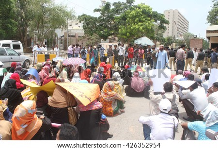 KARACHI, PAKISTAN - MAY 25: NTS passed teachers are protesting against nonpayment of their salaries for many months, outside Sindh Secretariat on  May 25, 2016 in Karachi.