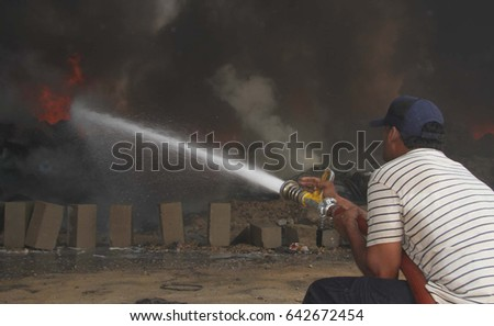 KARACHI, PAKISTAN - MAY 18: Views of fire eruption at plastic material godown located at dry cargo and goods terminal Maripur Road Gate No 06, in Karachi on May 18, 2017.