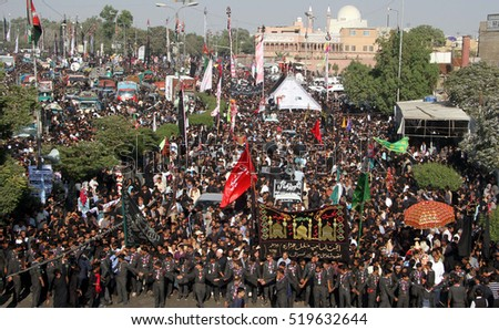 KARACHI, PAKISTAN - NOV 21: Shiite mourners of Imam Hussain (A.S) are participating  in procession in connection of 40th day (Chehlum), at M.A Jinnah Road on November 21, 2016 in Karachi.