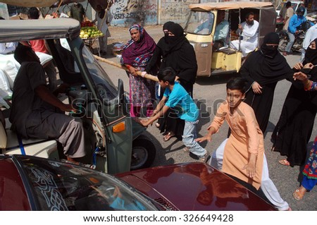 KARACHI, PAKISTAN - OCT 12: Residents of Lines Area are protesting against detention of their relatives by Rangers Sindh, held at Corridor III near Saddar on October 12, 2015 in Karachi.