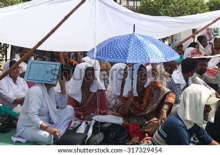 KARACHI, PAKISTAN - SEP 16: Doctors and paramedical staffs of Jinnah Hospital are  protesting against deduction in health risk allowances during a demonstration on September 16, 2015 in Karachi.