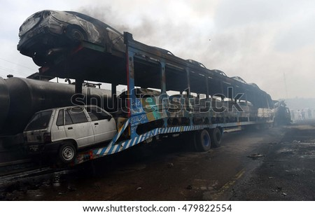 KARACHI, PAKISTAN - SEP 07: Views of venue after collide between oil tanker and a long trailer nearby Nooriabad on Super Highway on September 07, 2016 in Karachi.