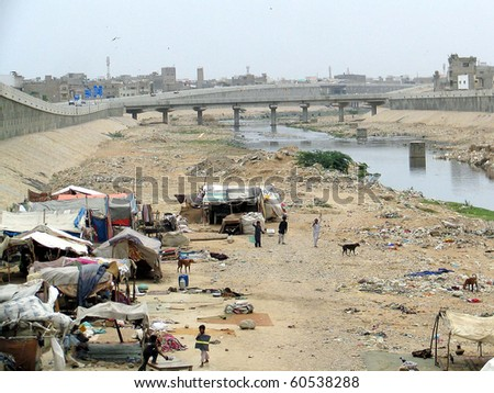 KARACHI, PAKISTAN-SEPT 02: View of newly established hut houses by people under Liyari Express Way at Gharibabad area on Thursday, September 02, 2010 in Karachi