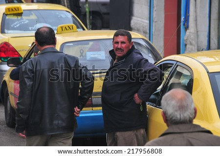 KARAK, JORDAN - JANUARY 8, 2009: Jordanian Taxi Stand and driver.