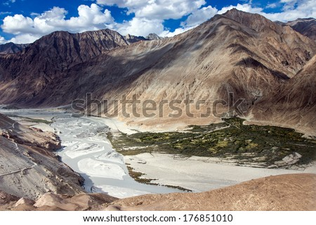 Karakoram mountain range and Nubra Valley - view from Khardung La Pass in Ladakh, North India - stock photo