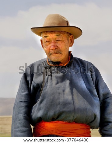 KARAKORUM , MONGOLIA - 30-04-2008; Mongolian man with traditional clothing is posing for the photographer at his town karakorum  - stock photo