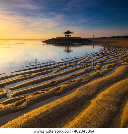 Karang Beach Sanur,Bali,Indonesia At Sunrise With Golden Sand Texture.Slightly noise and soft focus. - stock photo