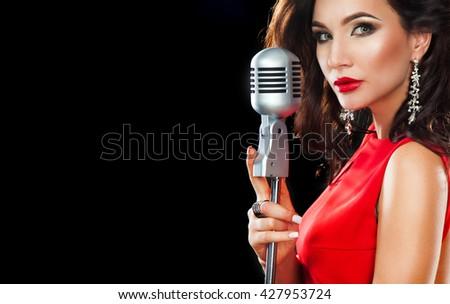 Karaoke Party. Beautiful Singing Girl. Woman in red with Microphone