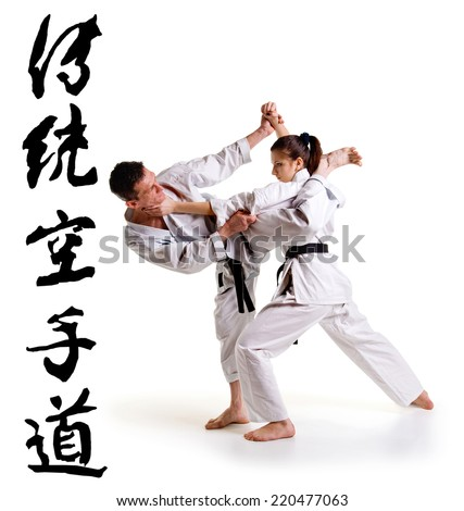 Karate athletes on a white background. Character karate