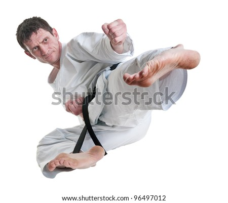 karate.battle blow.Training fight.figure of sportsman is in a jump.master of hand-to-hand fight on a white background. - stock photo