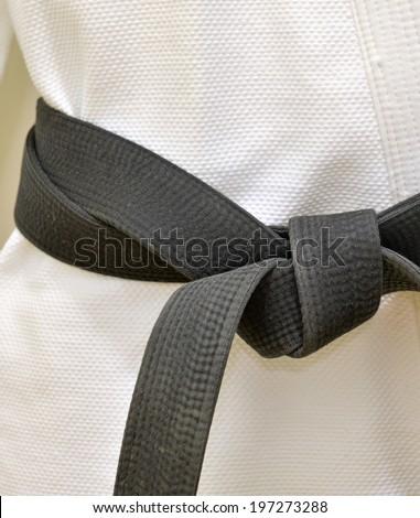 Karate Black Belt on White Uniform - stock photo