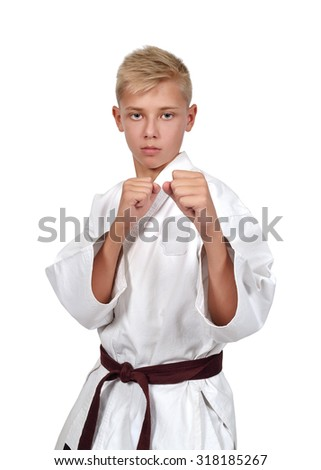 karate boy in white kimono with brown belt