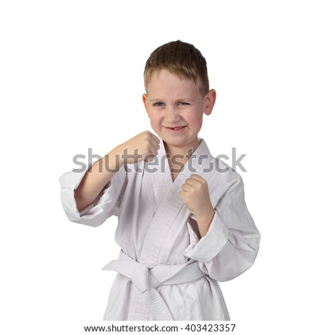 Karate boy stands in stance and going to punch isolated on white background in square