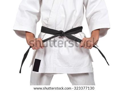 karate boy with black belt isolated on white background - stock photo