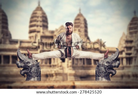 Karate fighter does the splits - stock photo