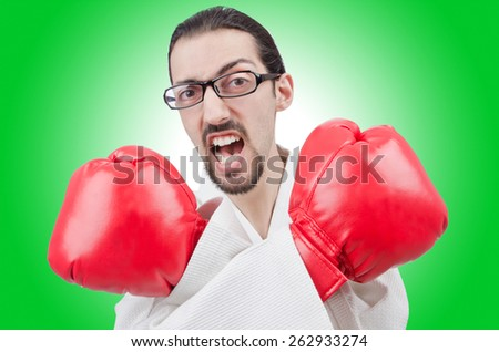 Karate fighter isolated on the white - stock photo