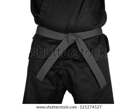 Karate grey belt tied around marital artists torso wearing black dojo GI's.
